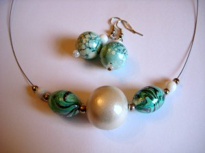 Marbled ceramic beads in aqua tones with white wooden bead